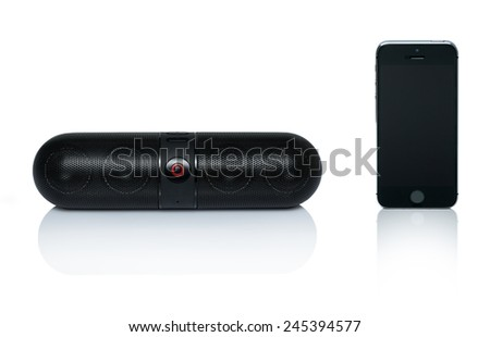 Bluetooth speaker that is connected to the Mobile phone, isolated, on a white background. - stock photo