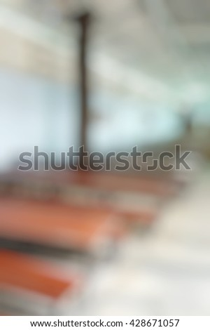 Blur abstract background empty urban wooden elementary school cafeteria. Blurry view of nobody kindergarten school canteen. - stock photo