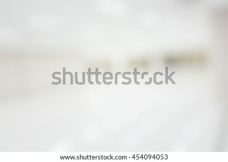 Blur abstract background hotel hospital corridor. Defocused clean white lobby office. Blurry wall and counter. Blurred view of aisle in office with light floor. - stock photo