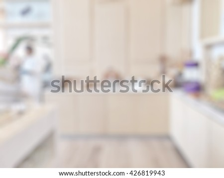 Blur abstract background luxury open kitchen in hotel restaurant facility showing serving buffet breakfast dinner lunch meal on table tabletop food display preparation with decoration - stock photo