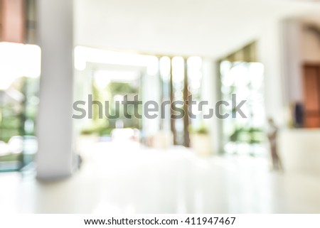 Blur abstract background luxury resort hotel entrance lobby waiting area empty space with glass door window: Blurry perspective view grand reception hall foyer vacation holiday relaxation interior - stock photo