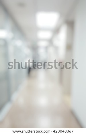 Blur abstract background of corridor in clean hospital. Blurred view of aisle in office with light floor - stock photo