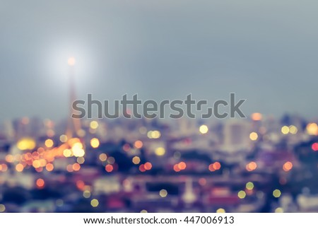 Blur abstract background rooftop view Bangkok cbd downtown city night light twilight bokeh in cool vintage cyan turquoise blue tone: Central business district on bridge landmark over Chao Phraya river - stock photo
