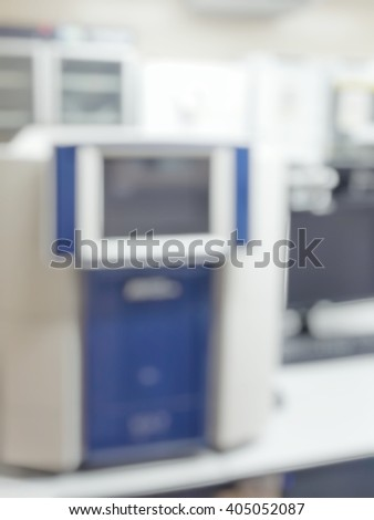 Blur abstract background white microbiology laboratory workstation office with incubator for research or education.Blurry view of nobody modern white medical or chemical lab room with freezer.  - stock photo