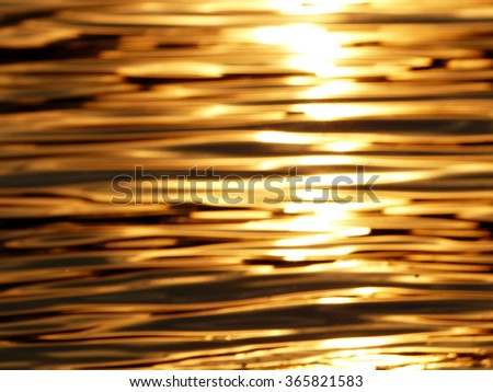 blur abstract golden reflection on water sunset - stock photo