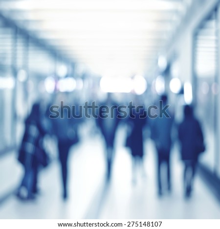 blur abstract people background, unrecognizable silhouettes of people walking  - stock photo