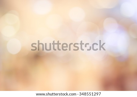 Blur aura shining brighten wallpaper with circle lantern:abstract blurred background in light warm toned.bulbs ball motion of golden yellow orange color backdrop.blurry wedding ceremony concept ideal. - stock photo