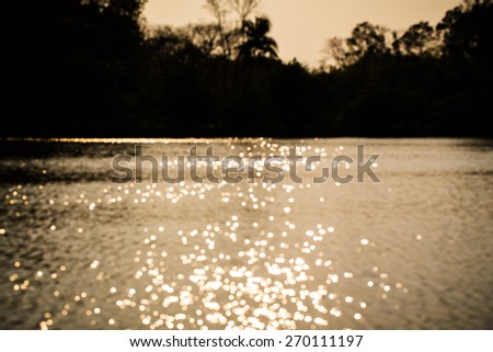 blur background beautiful sunlight on the river - stock photo