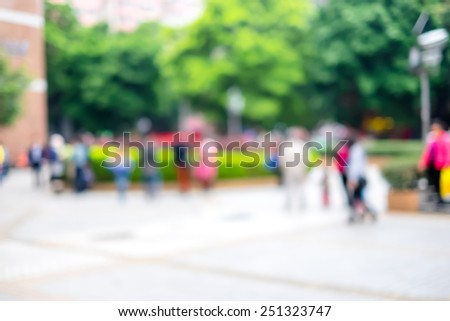 Blur background : crowd of people in city nature park. - stock photo