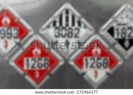 Blur Background Image - USDOT Hazardous Materials Transportation Placards on rear of a Fuel Tanker  - stock photo