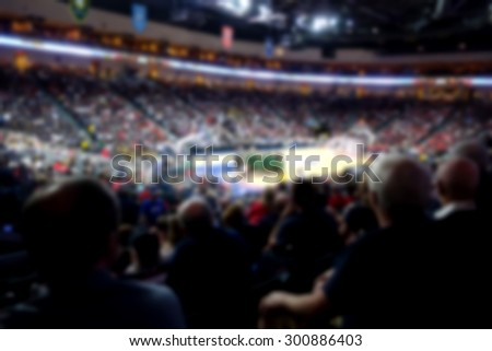 blur background of crowd watching sporting event                          - stock photo