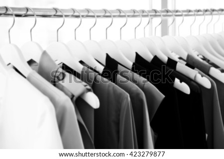 Blur background of fashion woman clothes hanging on rack - stock photo