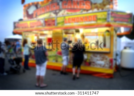 blur background of people at fair                                - stock photo