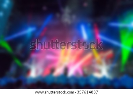 Blur background of people hanging out at the concert - stock photo
