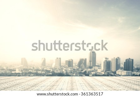 Blur big city at rooftop of hotel. Aerial Amazing Light Bangkok Thailand Asia Dinner Date Tower Town Food Capital History Sun Holiday Enjoy Viewpoint Drink Relax High Loggia Couple Love Africa concept - stock photo