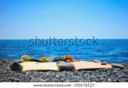 Blur blurred background rug sea shore and umbrella for the beach Summer seascape for background - stock photo