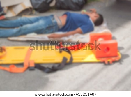 Blur blurred physician readiness yellow stretcher medical equipment casualty, assist a patient in emergency rescue situations. - stock photo