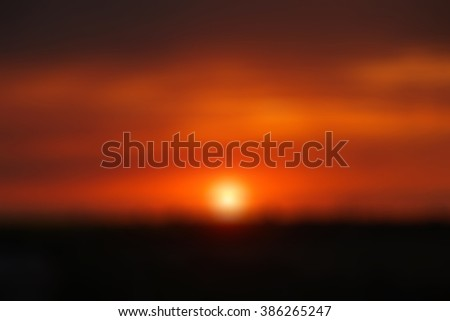 blur blurred unfocused soft abstract background texture wall wallpaper backdrop orange red dark color splash warm sunset clouds - stock photo