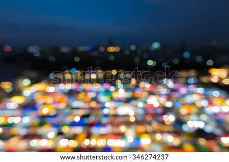 Blur bokeh background of multicolour lights of aerial view Bangkok night market - stock photo