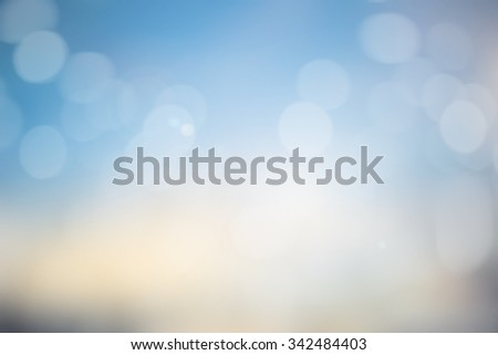 Blur bokeh christmas festive background:blurred wallpaper of circle bulbs lights for design and decorate:beautiful sunset backdrop concept. - stock photo
