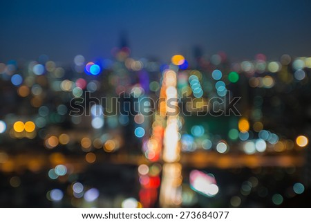 Blur bokeh of modern City cross road, lights during busy hours - stock photo