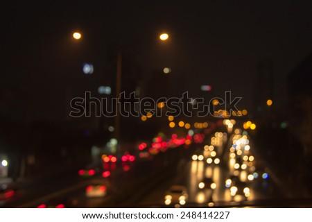 Blur bokeh traffic jam in rush hour - stock photo