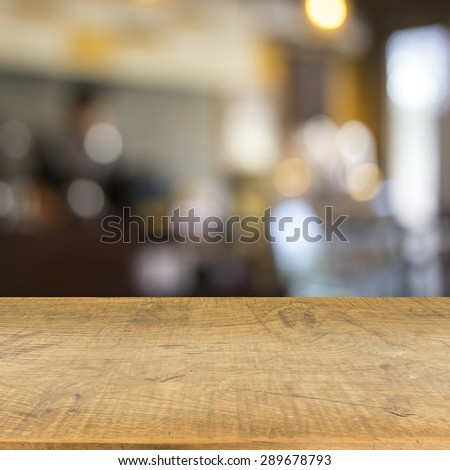 Blur cafe and wood floor texture background - stock photo