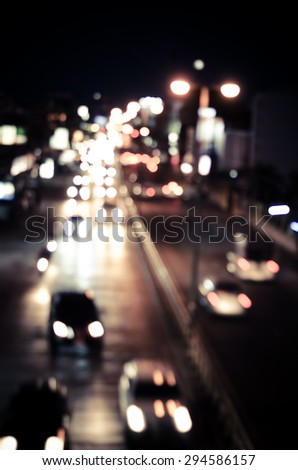 blur cars traffic on urban street tone vintage. - stock photo