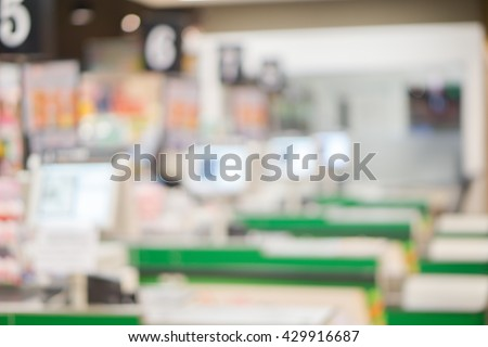 Blur cashier counter in the supermarket,Cashier at a supermarket checkout in a department store. - stock photo