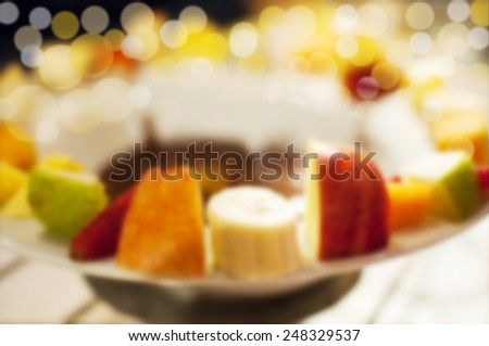 Blur Chocolate fondue with fresh fruits for background - stock photo
