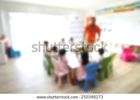 blur classroom with teacher and kids  - stock photo