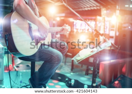 Blur Close up Guitar in music room - stock photo