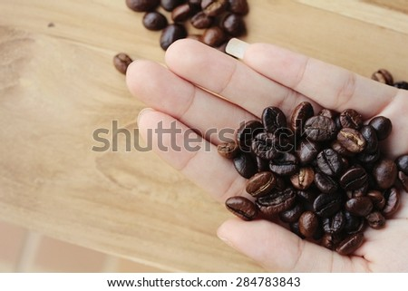 blur Coffee beans in the hands, Vintage style - stock photo