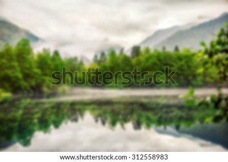 Blur defocus abstract background fog creeps over the water of Lower Blue Lake - stock photo