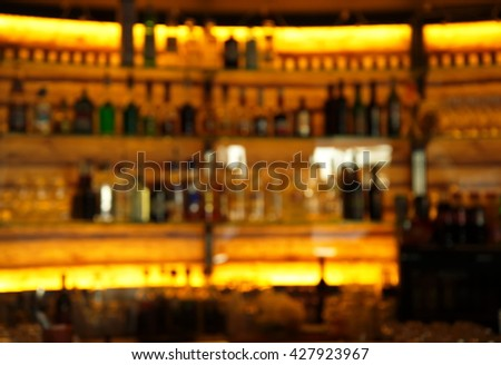 blur drink bottle at bar  - stock photo