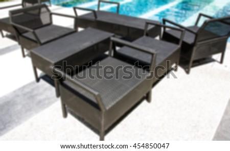 blur empty resting chair near swimming pool - stock photo
