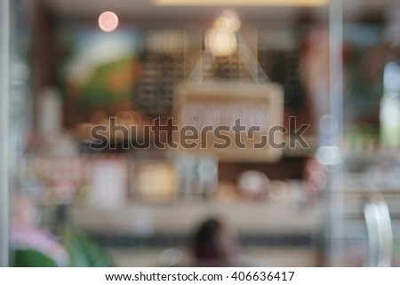 Blur front of shop glass door and open sign board - stock photo