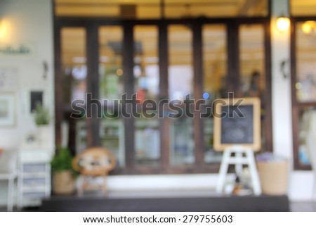 blur front of shop glass wood door and write board - stock photo