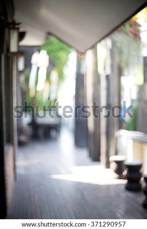blur front shop walk way green  tree - stock photo