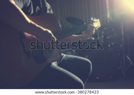 blur Guitarist on stage for background in vintage tone - stock photo