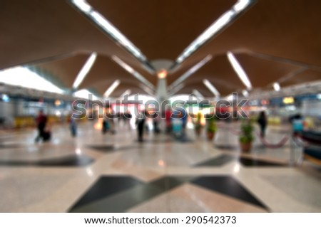 Blur image of an airport terminal - stock photo