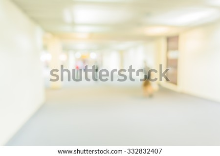 blur image of corridor and people in airport for background usage . - stock photo