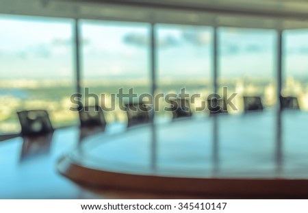 Blur image of empty boardroom with window cityscape background. Business concept - stock photo