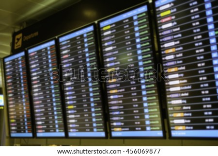 Blur image of flight information departure, arrival at the airport for background usage or create montage.  - stock photo