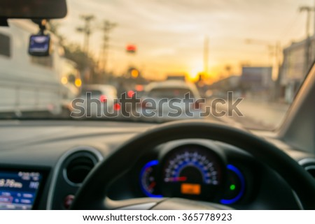 blur image of inside car with bokeh on day time for background usage. - stock photo