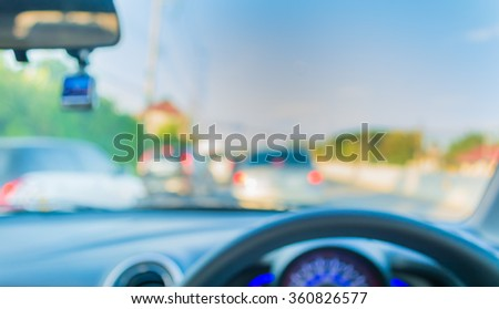 blur image of inside cars with bokeh on day time for background usage . - stock photo