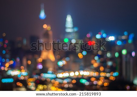 Blur image of Kuala Lumpur city with circle bokeh - stock photo