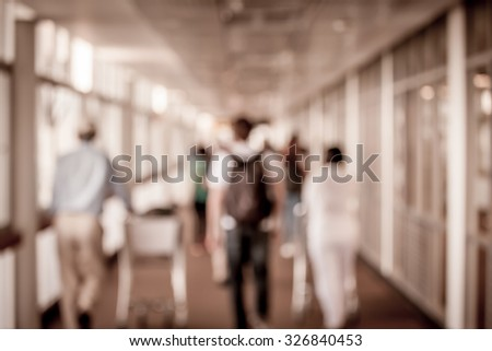 Blur image of passengers walking at airport in vintage color filter - stock photo