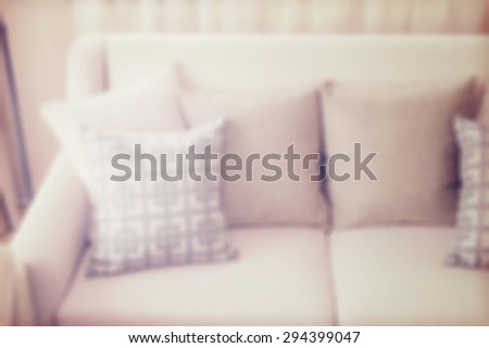 blur image of pattern pillows on beige sofa in the living room - stock photo