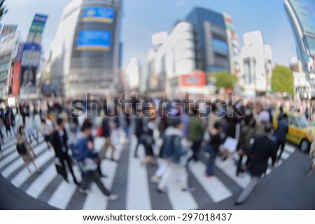Blur image of pedestrians walk at Shibuya district in Tokyo, Japan with fisheye view effect - stock photo
